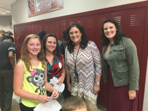 Teachers and children smiling
